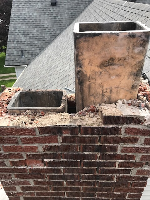 Construction on brick chimney
